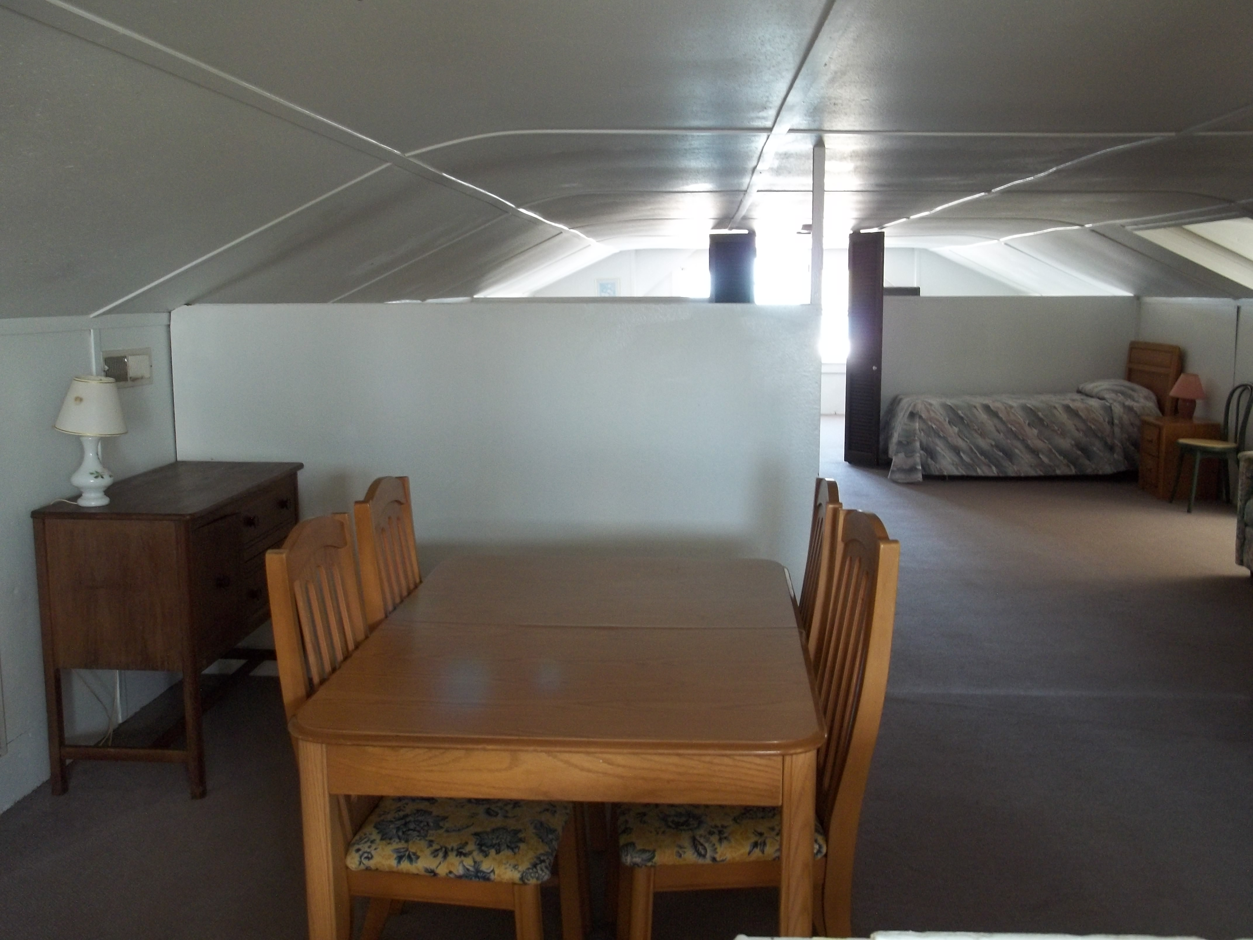 living area with table for 4 and single bed