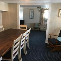 dining room with table for 6 and rocking chair