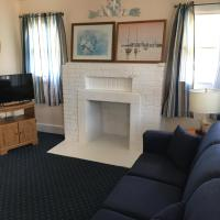 living area with hearth/mock fireplace