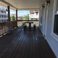 covered wooden deck and railing with bench