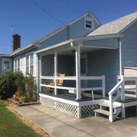 beach house exterior porch with rocking chairs