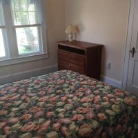 bedroom with full size bed and dresser