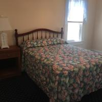 bedroom with full size bed and night stand