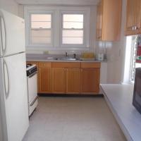 full kitchen with appliances and cabinets