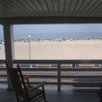 ocean and boardwalk view from balcony with rocking chair