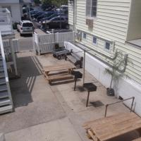 exterior patio with grills and table