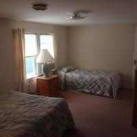 full size bed and single bed with nightstand