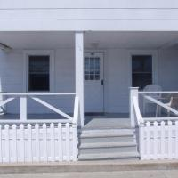 apartment exterior covered porch with chairs