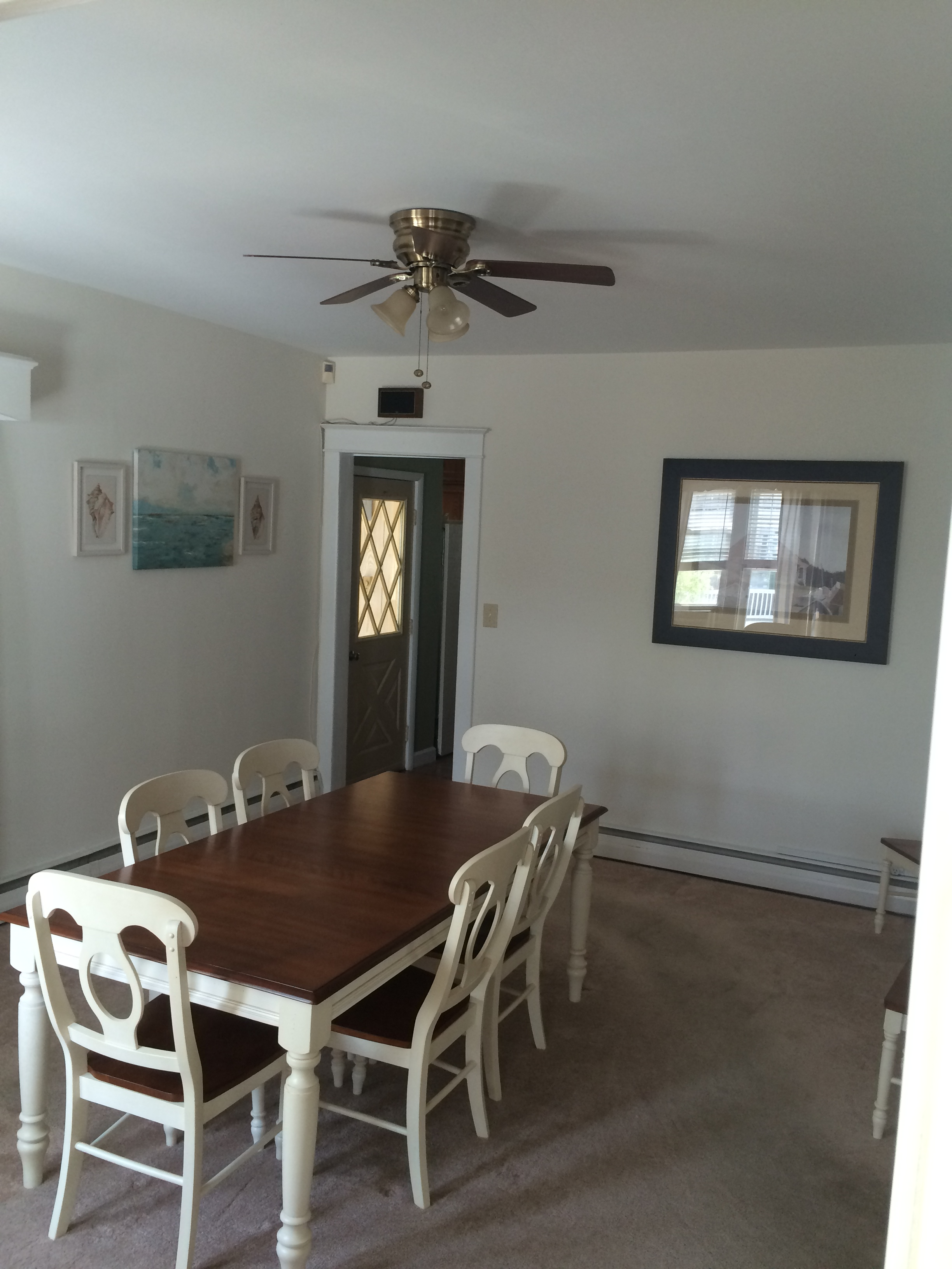 dining room with table for 6 and ceiling fan