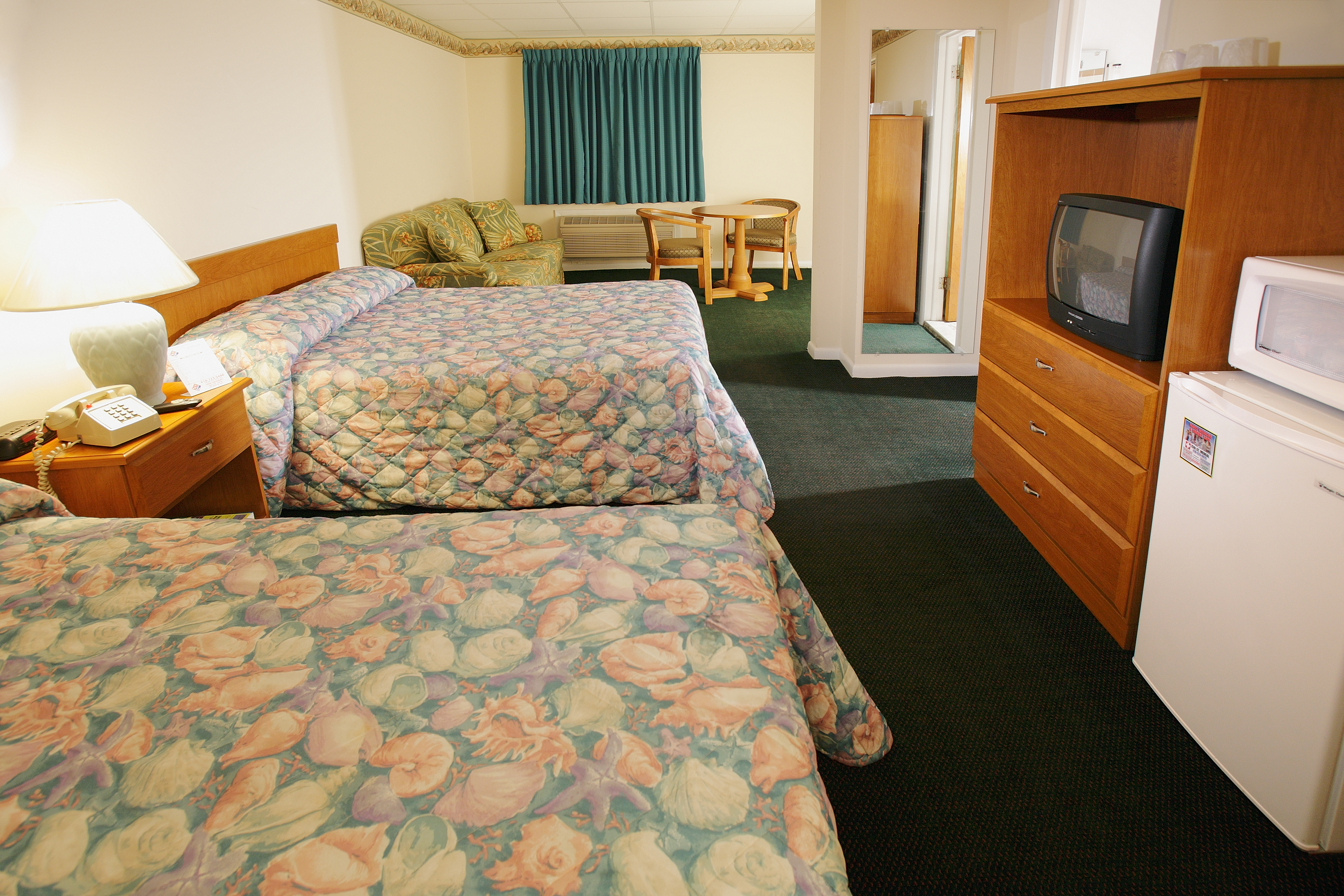 double room with 2 double beds and sofa
