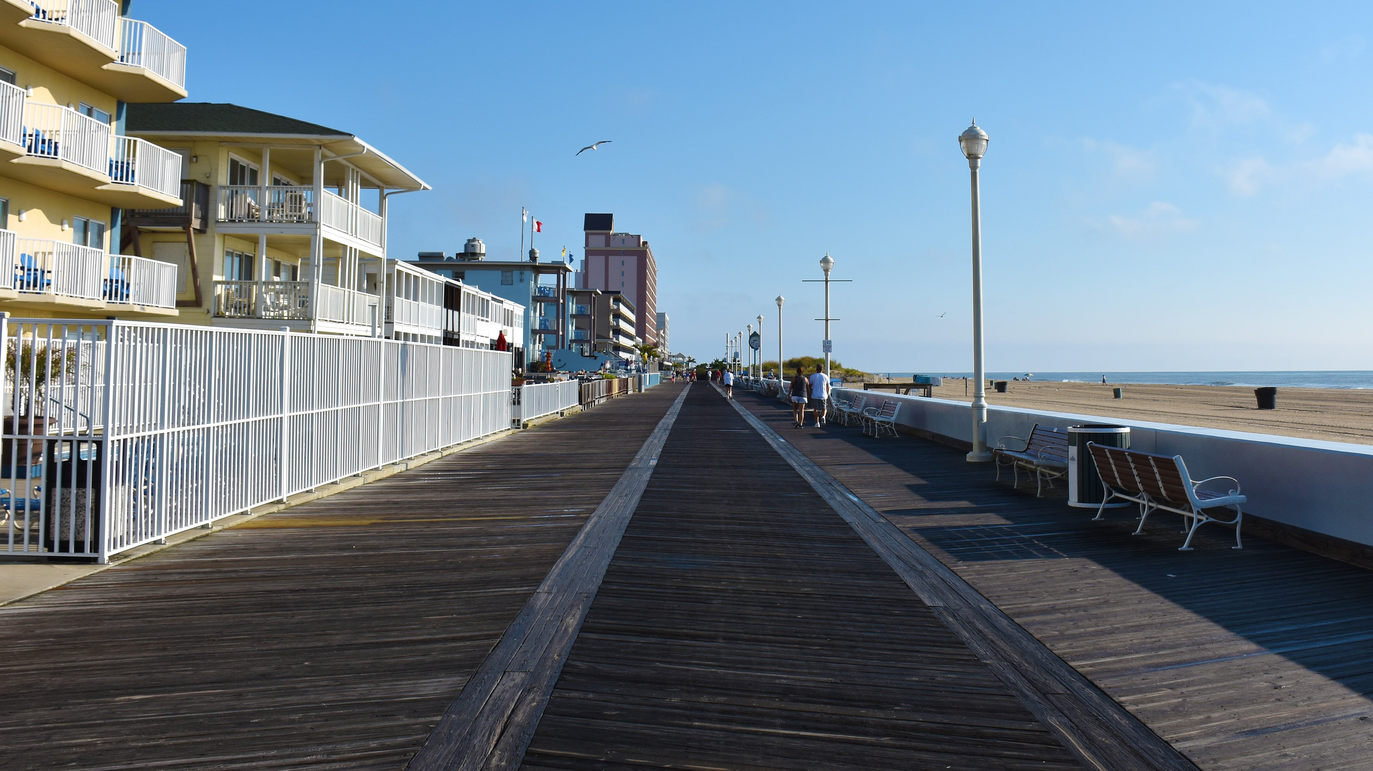 view of hotels and beach from boardwalk