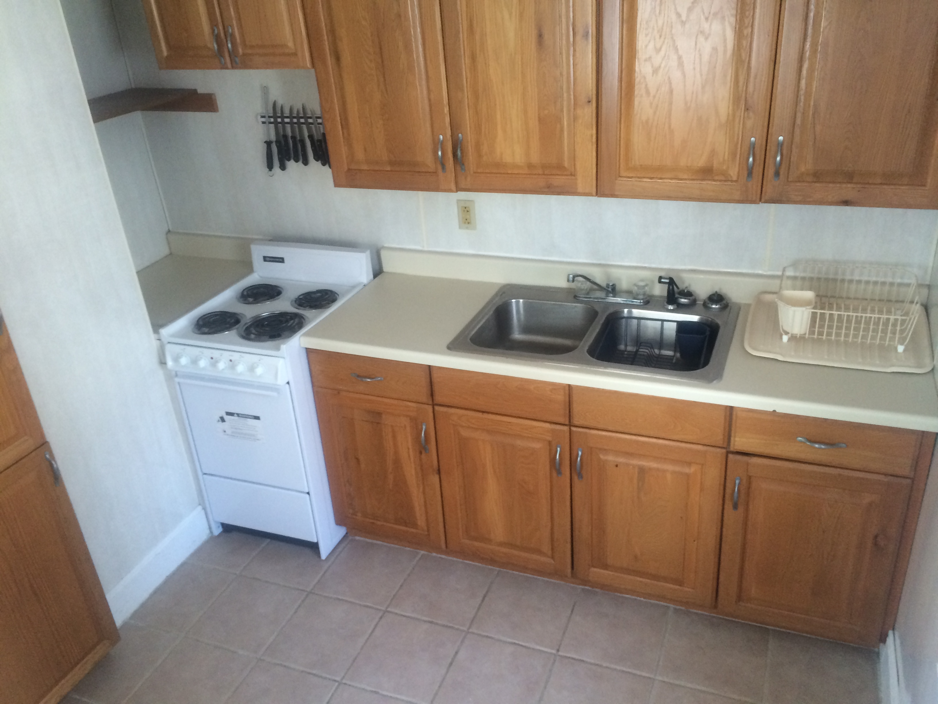 kitchen with stove, sink and cabinets