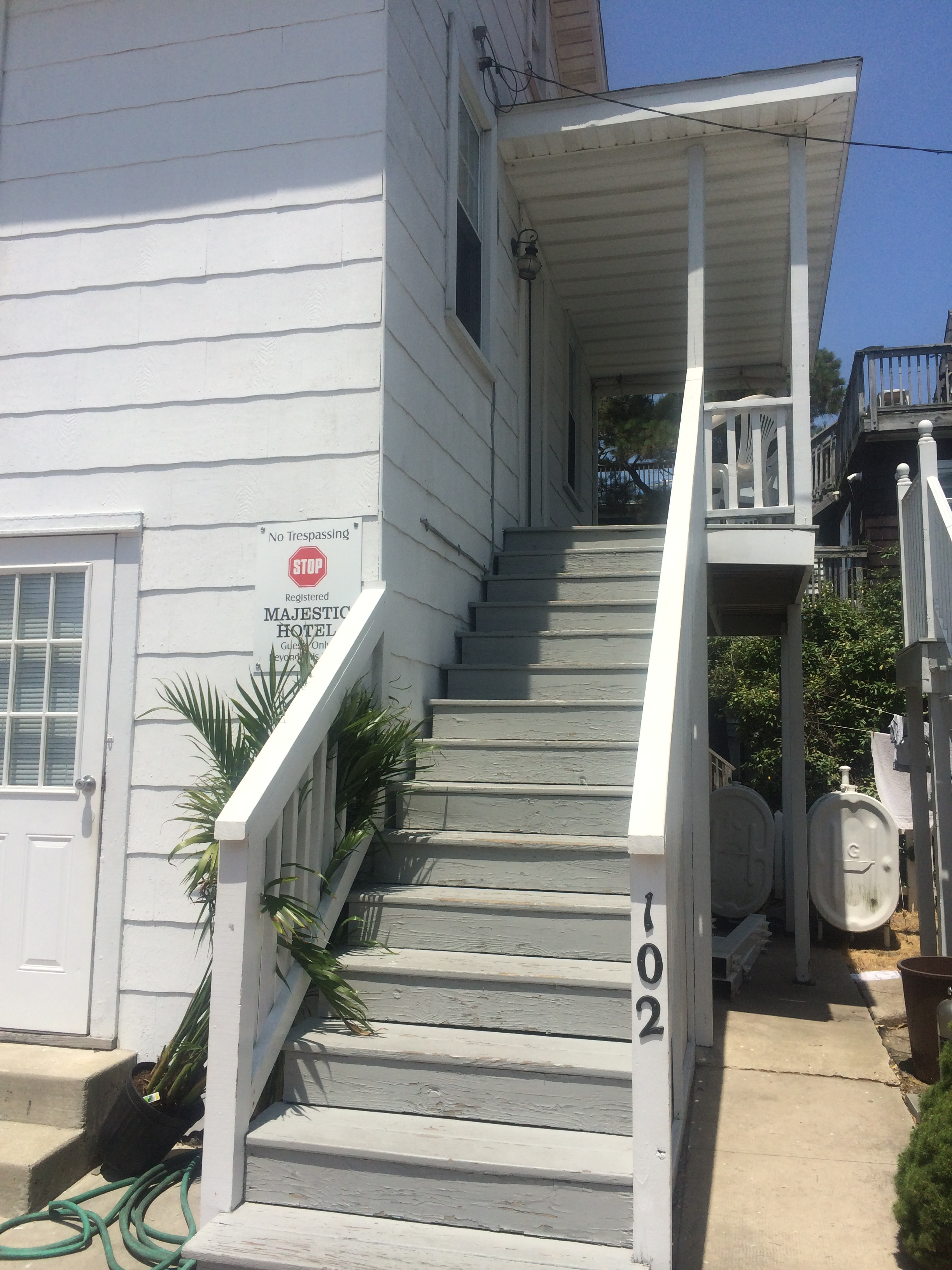 exterior stairs leading to apartment and balcony