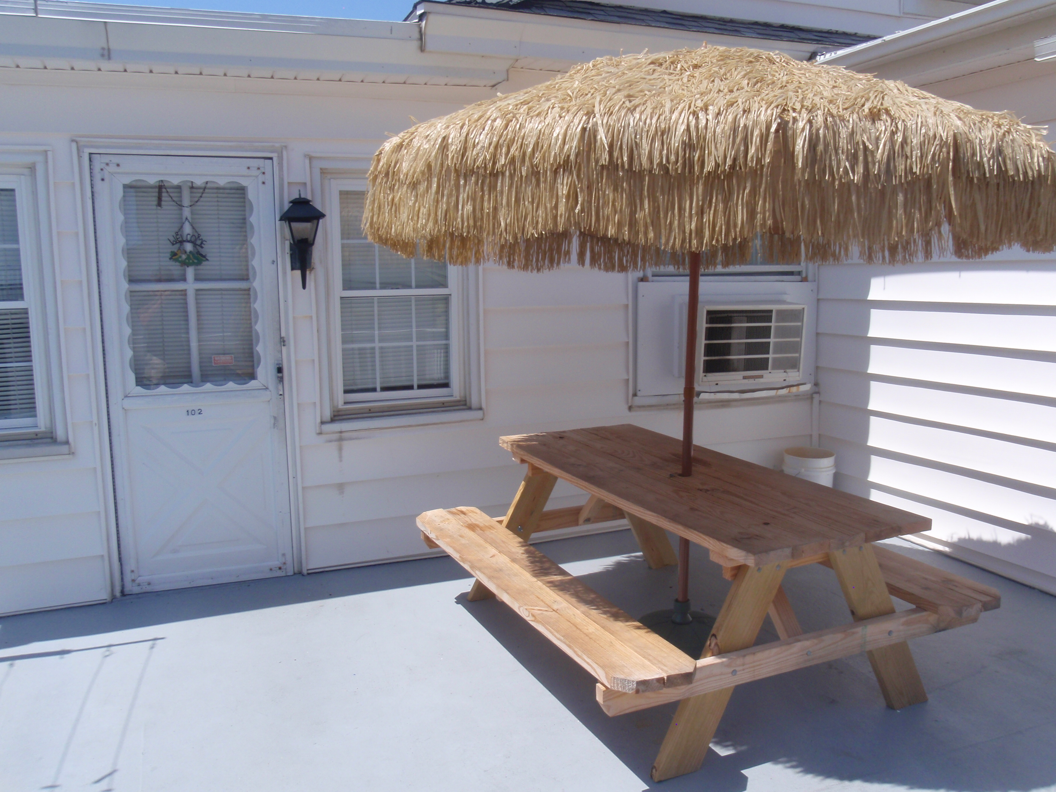 back deck with picnic style table with canopy